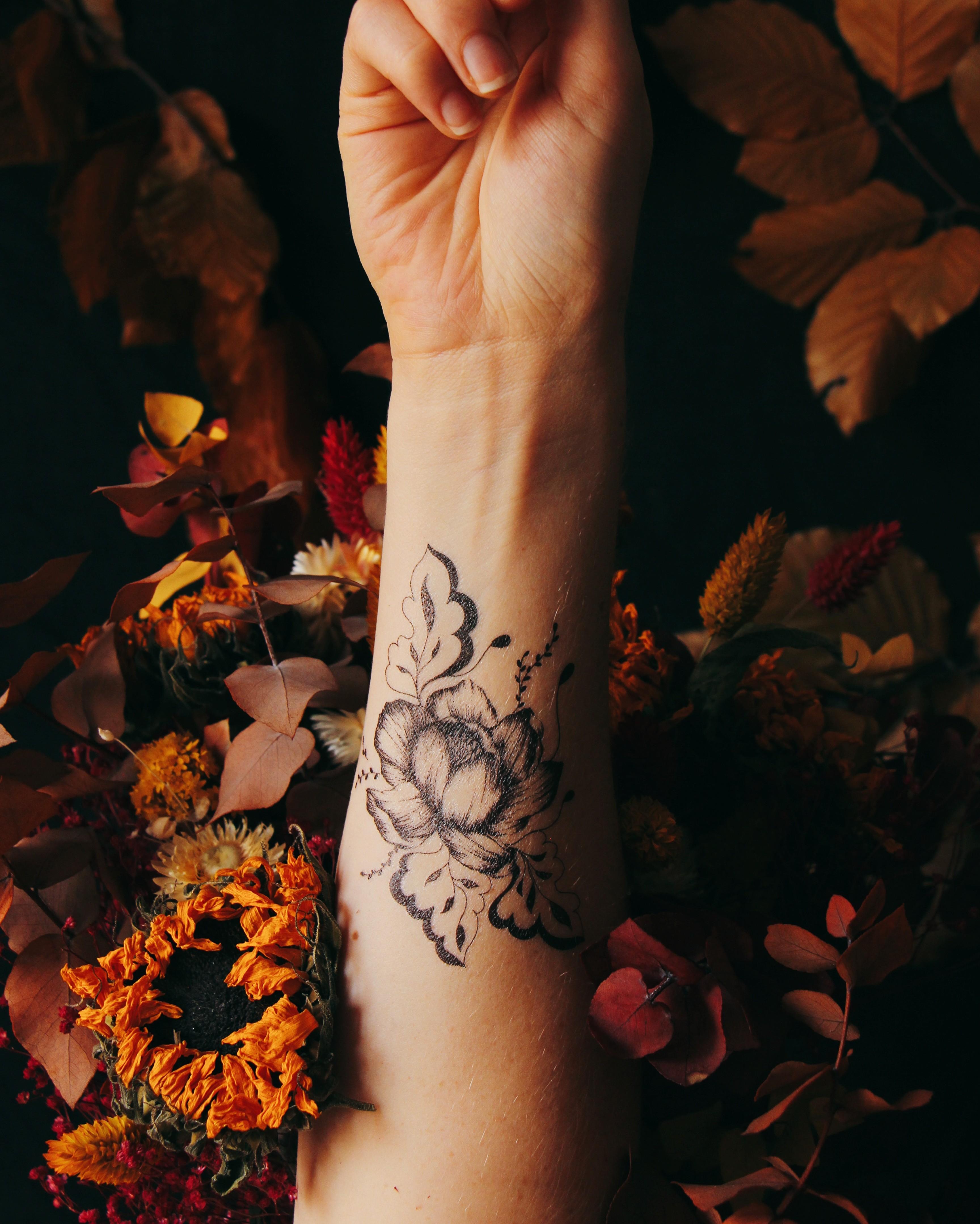 Tattoos Sioou floraux ultra-réalistes